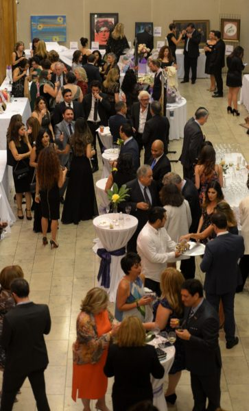 people socializing in the gala